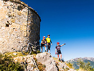 Mountain Bike riders looking the landscape in Catalonia (Spain)
