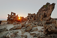 The setting sun finds a crevice in the unique formations of Point Roadknight, Australia.
