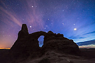Orion and the winter sky with Venus, setting into the western twilight, over Turret Arch in Arches National Park, Utah, on April 6, 2015. Venus is the bright object at right under the Pleaides. Sirius is the bright star at left, with Procyon the bright star ar top left.<br /> <br /> This is a stack of 7 x 30-second exposures for the ground to reduce noise, and a single 30-second exposure for the sky to keep the stars untrailed, all at ISO 3200 with the Canon 6D and Rokinon 14mm lens at f/2.8. Taken in late twilight.
