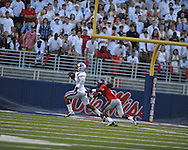 Central Arkansas' Al LAsker (83) makes a touchdown catch against Ole Miss defensive back Charles Sawyer (3) at Vaught-Hemingway Stadium in Oxford, Miss. on Saturday, September 1, 2012.