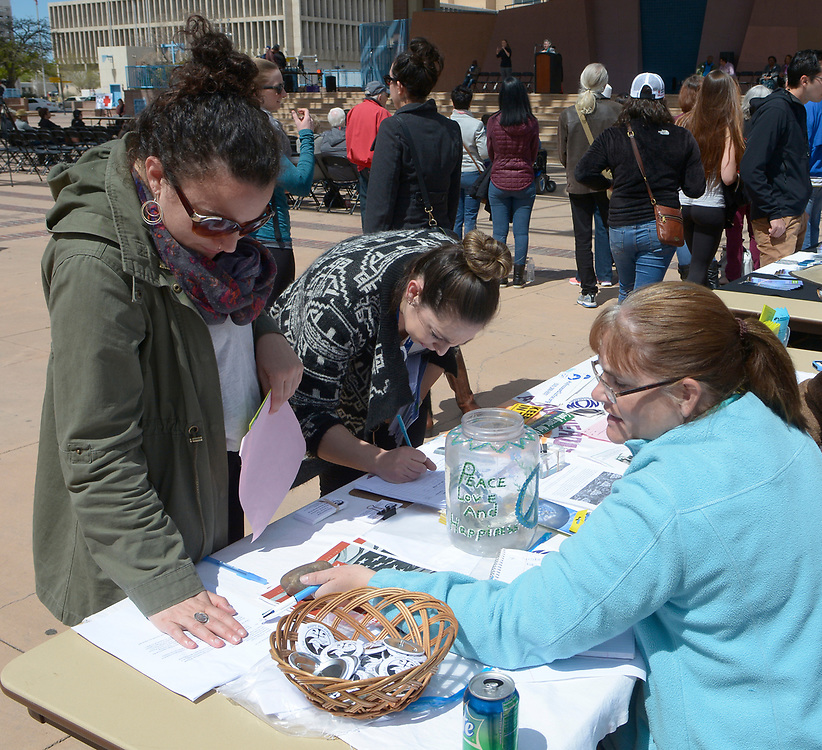 gbs040217t/ASEC -- Emily Pepin, and Brittany DuChaussee,both of Albuquerque, talk to Kelly King, from left,  at the Peace and Justice Center table  during the Rally Against Sexual Violence in the Albuquerque Civic Plaza on Sunday, April 2, 2017. (Greg Sorber/Albuquerque Journal)