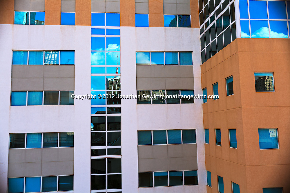 Fragments of the Miami, Florida skyline as reflected from an office building adjacent to a downtown Metromover station. WATERMARKS WILL NOT APPEAR ON PRINTS OR LICENSED IMAGES.