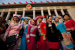 Delegates in ethnic minority costumes pose for photos as they arrive for the opening session of the National Peoples Congress (NPC) in the Great Hall of the People in Beijing, China, on 05 March 2011. The NPC has over 3,000 delegates and is the world's largest parliament or legislative assembly though its function is largely as a formal seal of approval for the policies fixed by the leaders of the Chinese Communist Party.