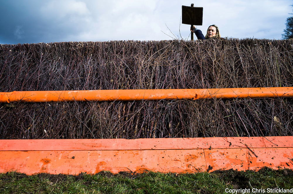 A fence marshall evens out the top of a fence in preparation for the second race of the day at Friars Haugh in Kelso.