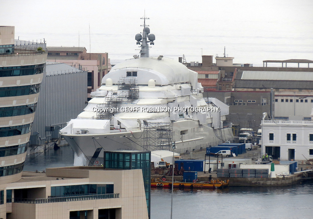 PIC BY GEOFF ROBINSON PHOTOGRAPHY 07976 880732...PIC SHOWS THE WORLDS BIGGEST SUPER YACHT CALLED ECLIPSE OWNED BY ROMAN ABRAMOVICH HAVING A RE FIT IN BARCELONA,SPAIN,ON MAY 17TH 2012.THE YACHT IS COVERED IN TURPAULIN TO STOP PEOPLE SEEING WHAT WORK IS GOING ON...Chelsea FC owner Roman Abramovich who owns the world?s largest private superyacht is having it re-fitted after just TWO years.When the Russian tycoon bought the 557ft-long yacht, Eclipse, in 2010 it beat the 532-foot yacht Dubai, owned by ruler of Dubai Sheikh Mohammed bin Rashid al-Maktoum, to become the biggest in the world..But amid rumours Sheikh Mohammed is having his yacht extended by as much as eight feet to recapture the title, Mr Ambramovich has now booked his boat in for a re-fit in Barcelona harbour..The mega-yacht is currently moored in the harbour, where it is covered in tarpaulin and scaffolding while the secret work is carried out by Marina Barcelona 92..It is not known exactly what alterations are being done to the yacht, which Mr Abramavich, who will be in Germany tonight (Sat) for the Euro Cup final, initially bought for around £330 million..SEE COPY CATCHLINE Abramovich yacht re-fit..
