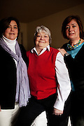 Linda Groeber, 67 (center), and her daughters Tracey Brown (L) and Annie Groeber (R), pose for a portrait during a family visit in Lutherville-Timonium, Maryland on Wednesday, January 13, 2010. As she ages Linda has relied more on her daughters Tracey Brown and Annie Groeber to help with day-to-day tasks, which can cause tension between the siblings.
