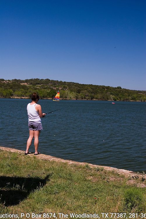 Lady fishing in the early spring at Inks Lake State Park