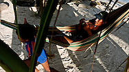 Kuna Indian resting on a hammock