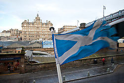A saltire flies in the wind near The Balmoral, a luxury five-star hotel and landmark in Edinburgh, Scotland, was known as the North British Hotel until the late 1980's. It's location is in the heart of the city, at the east end of Princes Street..Pic © Michael Schofield.