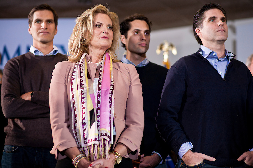 Republican presidential candidate Mitt Romney's wife Ann and three of their five sons, Josh Romney, Craig Romney, and Tagg Romney, from left, listen during a campaign rally at the Mississippi Valley Fairgrounds on Monday, January 2, 2012 in Davenport, IA.