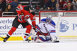 Oct 21, 2014; Newark, NJ, USA; New Jersey Devils right wing Jaromir Jagr (68) looks for the puck after a save by New York Rangers goalie Henrik Lundqvist (30) during the first period at Prudential Center.