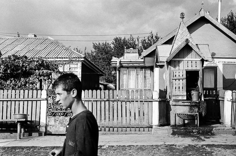 Catalin Cogalniceanu, in 2000, when he was 15, walking in a street of the village of Popricani