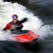 Whitewater kayakers participate in the third annual Golden Community Rodeo 2005 Wednesday June 15, 2005 at the Golden Play Park. Men's expert competitor Brook Aitken (cq), 32, of Boulder paddles in a standing wave during the competition. The event featured about 50 kayakers competing for prizes in categories based on skill levels and judged on variety of tricks in a 35 second timed run. The competition was the last of a series of four held at the park. .(MARC PISCOTTY / © 2005) CQ Brook Aitken