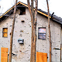 Home Damaged by EF2 Tornado in 2012 in Branson, Missouri<br /> On February 29, 2012, Branson, Missouri, was blasted by an EF-2 tornado. The estimated 113 - 157 mph winds damaged homes, theaters and blew out over 200 windows in the Hilton Convention Center. Notice the 2x4s and debris lodged into this siding. The home looks like it was hit by a giant shotgun blast.