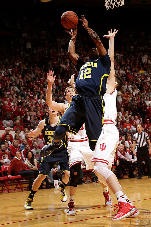 Michigan guard Muhammad-Ali Abdur-Rahkman (12) as Michigan played Indiana in an NCCA college basketball game in Bloomington, Ind., Sunday, Feb. 8, 2015. (AJ Mast / Photo))