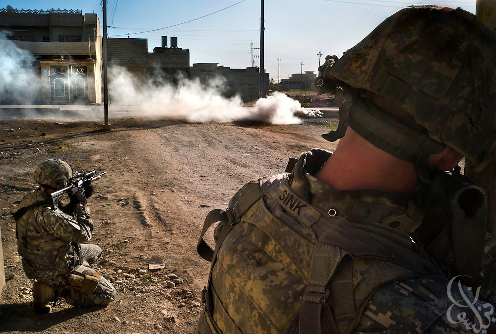 U.S. Army 1st Cavalry Division 2-7 soldiers take up positions behind cover of a smoke grenade during an October 18, 2007 mission in Mosul, Iraq. U.S. soldiers usually conduct joint U.S.-Iraqi raids, however also undertake unilateral missions too depending on the level of importance of the target, sensitivity of the mission, or time limitations.