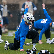 Duke long stick midfielder Brian Dailey #21  stretches before game with Notre Dame. The third-ranked Fighting Irish defeated sixth-ranked Duke, 13-5, in men's lacrosse action on a snowy Saturday afternoon at Koskinen Stadium in Durham, N.C.