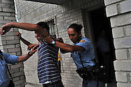 At right, officer Claudia Gonzalez searches an individual after a reported domestic dispute on August 19, 2010 in Laredo, Texas. Laredo has been beefing up its police force to deal with the possibility of spillover violence, but crime remains relatively low with only six murders this year. City officials say negative attitudes about the city's more dangerous sister Nuevo Laredo have kept tourists from coming and effected the over all economics of the town.