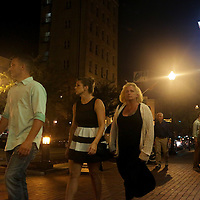 People walk down Front Street Saturday August 23, 2014 in Wilmington, N.C. (Jason A. Frizzelle)