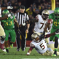 Florida's quarterback James Winston (5) watches as Tony Washington (91) recovers a loose ball during the third quarter of the Rose Bowl.