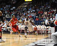"Ole Miss' Nick Williams (20) vs. Illinois State's Tyler Brown (1) in a National Invitational Tournament game at the C.M. ""Tad"" Smith Coliseum in Oxford, Miss. on Wednesday, March 14, 2012. (AP Photo/Oxford Eagle, Bruce Newman)"