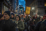 Protesters in Lower Manhattan marching in the streets, after the Trump administration implemented a ban on entry to citizens of 7 Muslim-majority nations into the United States.  New York, New York, USA.  29 January 2017