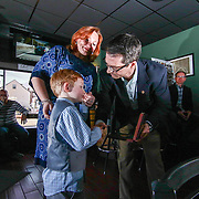 Right to Left Michael J. Manley Jr (5) and Amy Jo Fosdick is presented the Carnegie Award from Eric P. Zahren of The Carnegie Hero Fund Commission Saturday, Feb. 18, 2017, at North Quarter Creole in Wilmington, DEL