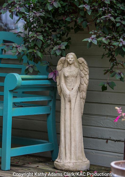 porch garden, bench, angle statue, Garden, Houston, late summer, Texas.