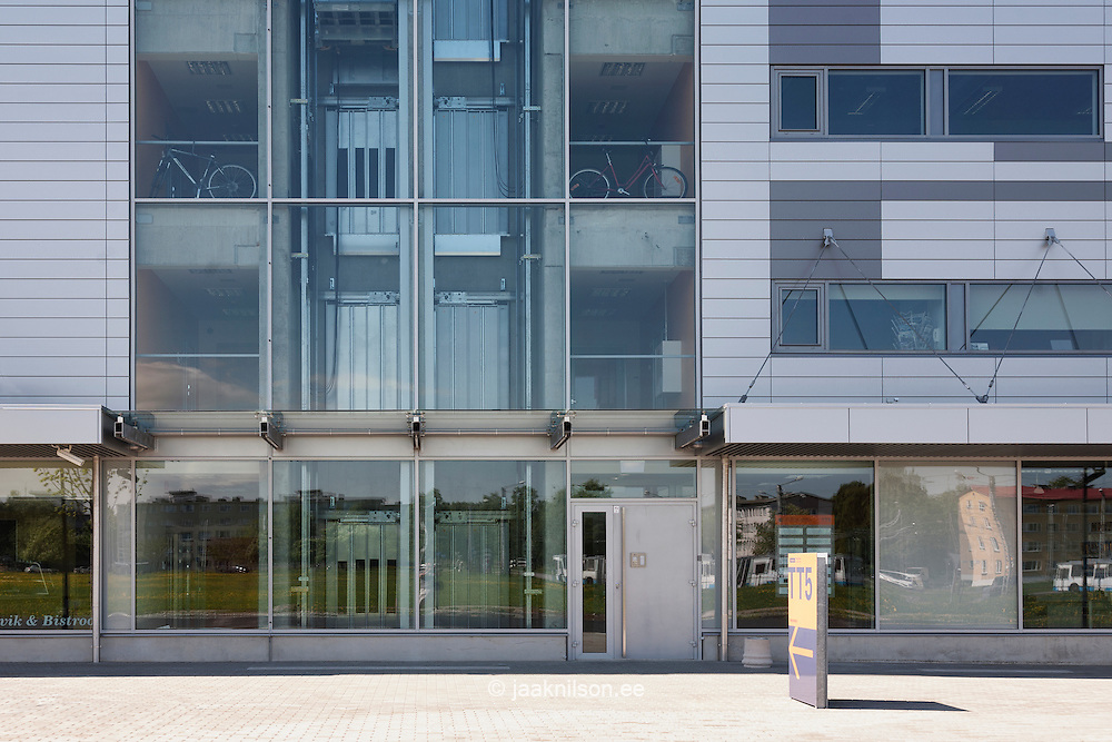 Large Modern Building With Glass Exterior Walls Front Entrance Door Transparent Windows And
