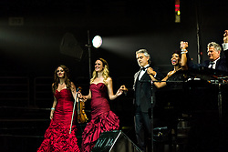 ANAHEIM, CA - JUN 9: Italian tenor Andre Bocelli performed Granada, New York, La Boheme, LaTraviata among others keeping audience mesmerized at the Honda Center in Anaheim, CA. The magical night included producer David Foster on Piano, Violinist Caroline Cambell, American Idol Season 3 winner Soul Singer Fantasia, Cuban Soprano Maria Aleida and Orchestra Conductor Eugene Kohn. Maria Aleida, Caroline Campbell, Andrea Bocelli, Fantasia Barrino and David Foster bow to the last standing ovation. All fees must be agreed prior to publication, Byline and/or web usage link must  read  PHOTO: SilvexPhoto.com