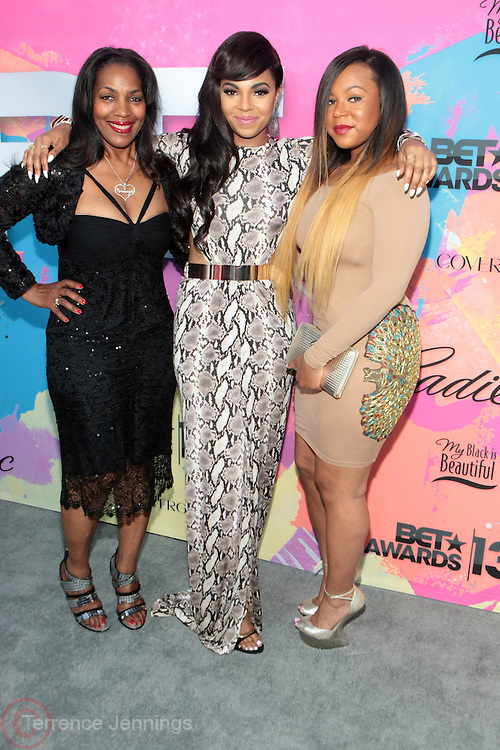 """Los Angeles, CA-June 29:  (L-R) Tina Douglas, Recording Artist/Actress Ashanti Shequoiya Douglas and her sister Kenashia Douglas attend the Seventh Annual """" Pre """" Dinner celebrating BET Awards hosted by BET Network/CEO Debra L. Lee held at Miulk Studios on June 29, 2013 in Los Angeles, CA. © Terrence Jennings"""