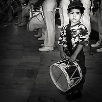 Young boy with his drum playing with the naval orchestra in Veracruz Mexico