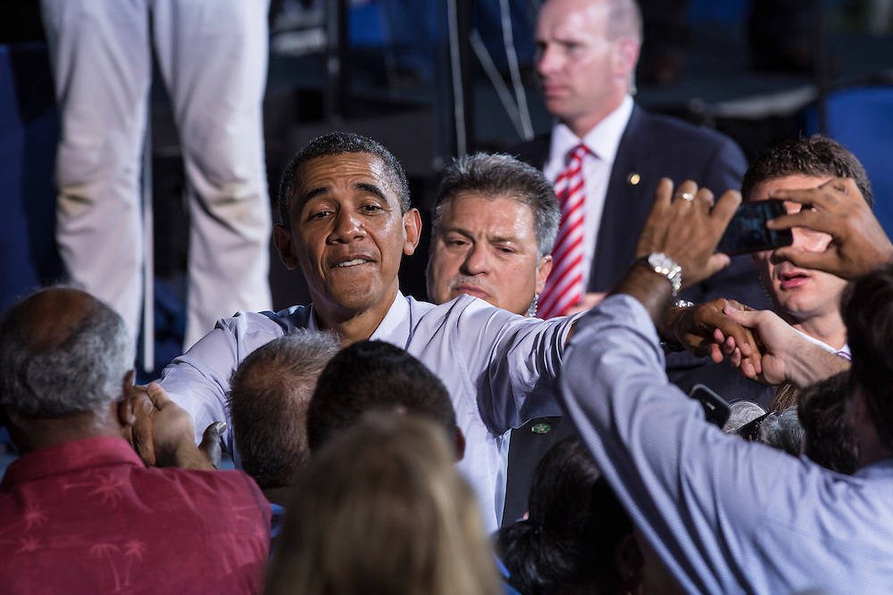 ARLINGTON, VA - AUGUST 2: President Barack Obama shakes hands with audience members at the end of a campaign rally at Loudoun County High School on August 2, 2012 in Leesburg, VA. Obama campaigned earlier in the day in Florida. (Photo by Brendan Hoffman/Getty Images) *** Local Caption *** Barack Obama