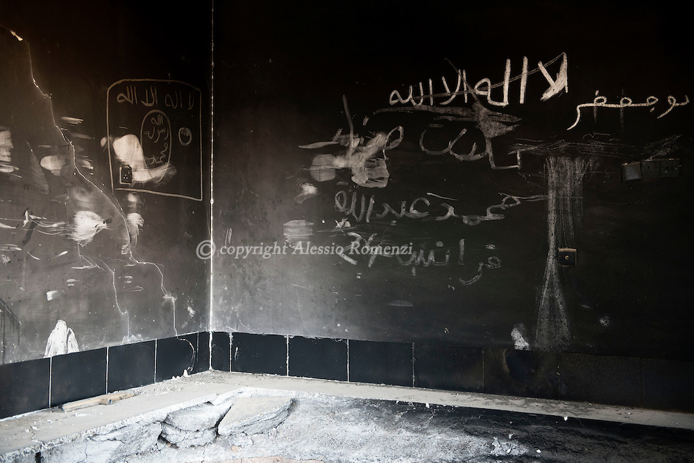Iraq, Cartella: ISIS writings inside a house used as base in Cartella village. Alessio Romenzi