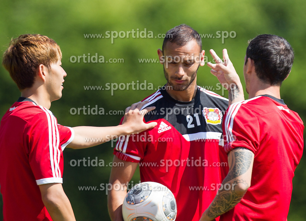 17.07.2013, Alois Latini Stadion, Zell am See, AUT, Bayer 04 Leverkusen Trainingslager, im Bild Heung-Min Son, (Bayer 04 Leverkusen) und Sebastian Boenisch, (Bayer 04 Leverkusen) geben Oemer Toprak, (Bayer 04 Leverkusen) einen Ohrenschnipser // during a Trainingssession of the German Bundesliga Club Bayer 04 Leverkusen at the Alois Latini Stadium, Zell am See, Austria on 2013/07/17. EXPA Pictures © 2013, PhotoCredit: EXPA/ Juergen Feichter