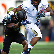 SHOT 9/6/09 5:44:14 PM - Colorado State's Leonard Mason (#2) tries to escape the tackle of Colorado's Jimmy Smith (#3) during the first half of the 2009 Rocky Mountain Showdown at Folsom Field in Boulder, Co. Colorado State upset Colorado 23-17 in the game. (Photo by Marc Piscotty / © 2009)