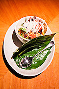 Spicy pork with mint, peanuts and crunchy rice on betel leaves. Nahm restaurant at The Metropolitan hotel.
