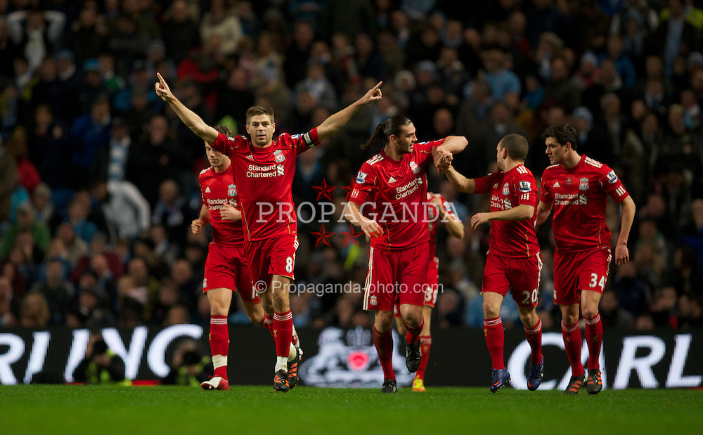 MANCHESTER, ENGLAND - Wednesday, January 11, 2012: Liverpool's captain Steven Gerrard celebrates scoring the first goal against Manchester City from the penalty spot with team-mates during the Football League Cup Semi-Final 1st Leg at the City of Manchester Stadium. (Pic by David Rawcliffe/Propaganda)