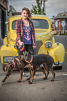 """Customer Care Attendant at Clear Captions, Dayla Pearl with her dogs Luna and Squeaky in Roseville, California  """"I love when people are happy after our phone calls...the service is free and very satisfying.""""  (1939 Chevrolet)"""