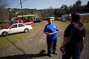 Winnemem chief and spiritual leader Caleen Sisk-Franco, center, and tribal memeber Julie Scholfield, right, chat in their village, called Tuiimyali, in Jones Valley, Calif. March 17, 2010.