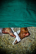 After the major fireaccident on Sep 5th 2012,corpse of the victims were arranged at mortuary of the Government Hospital. A note carrying the name of the victim is tied to the legs. Image © Balaji Maheshwar/Falcon Photo Agency