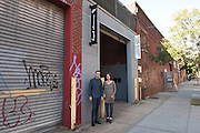 Gallery owners Andrea Monti and Ellen Burchill in front of their Microscope Gallery at 1329 Willoughby Ave, Bushwick, Brooklyn.<br /> <br /> Brooklyn Artists October 2015<br /> <br /> &copy; Stefan Falke<br /> stefanfalke@mac.com<br /> www.stefanfalke.com