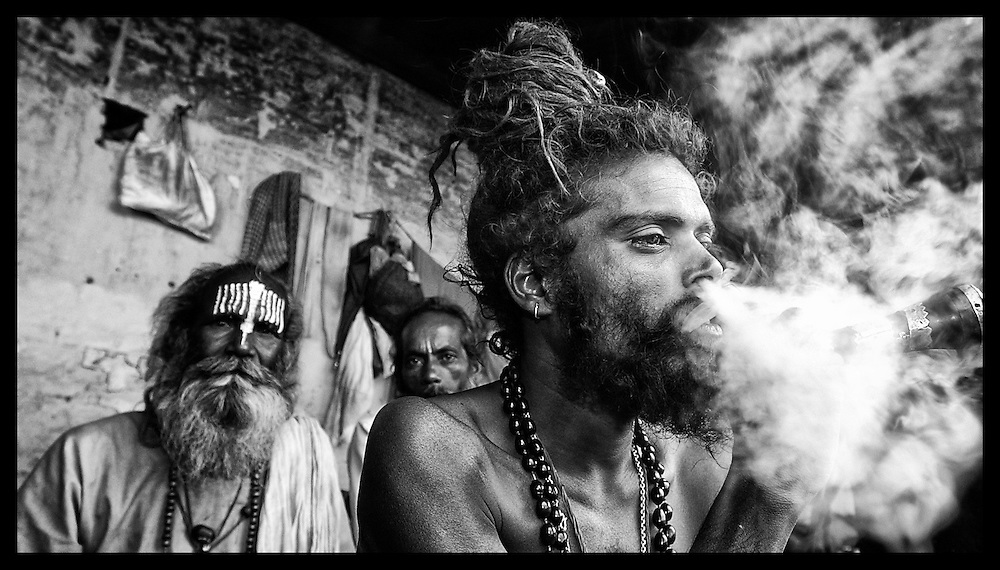 Katmandu, Nepal Holy men, also know as Sadhus, smoke marijuana at one of the many cities Hindu temples.