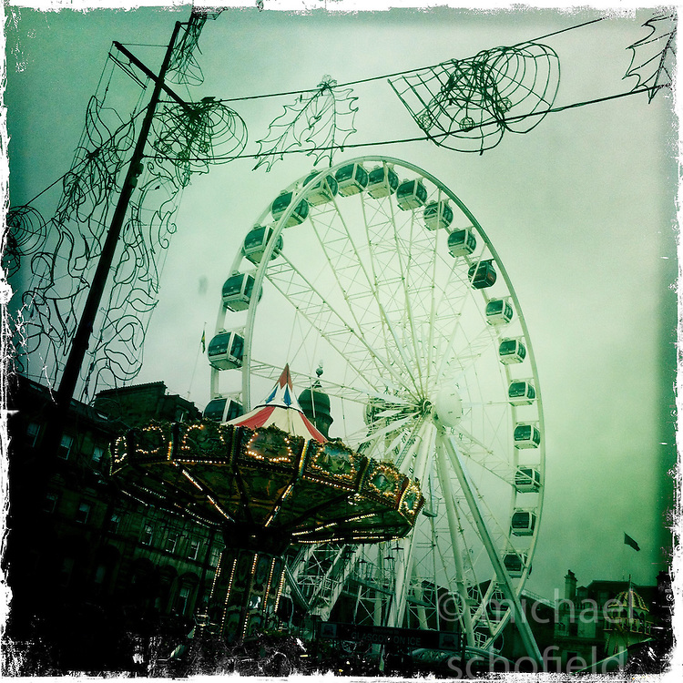 Christmas lights and giant Ferris wheel, Glasgow..Hipstamatic images taken on an Apple iPhone..©Michael Schofield.