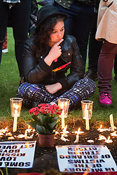Church of St. Ann, Soho, London, June 13th 2016. Thousands of LGBT people and their friends converge on Old Compton Street in London's Soho to remember the fifty lives lost in the attack on gay bar Pulse in Orlando, Florida. PICTURED: A woman at the Church of St. Ann, Soho takes a moment to contemplate those killed in Orlando.