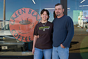 """Greensburg, Kansas, USA..Tim and Kari Kayle, owners of Grenn Bean Coffe Co...""""Greensburg: Better, Stronger, Greener!"""".On May 4, 2007, an EF5 tornado cut a 1.7-mile path of destruction through Greensburg, Kansas. Winds reaching speeds of 205 miles per hour uprooted trees, demolished homes and leveled the town. Eleven people died and 95% of the buildings were destroyed beyond repair. Residents have since worked furiously to rebuild it in a way that is both economically and environmentally sustainable and to meet the highest environmental standards. Greensburg, whose population has dropped from about 1400 to 800 following the storm and is now growing again, is currently the greenest town in America and the first in the United States to pass a resolution to certify that all city-owned buildings earn LEED Platinum accreditation, the highest level of the LEED rating system...Foto © Stefan Falke"""