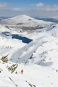 A walker descends the Watkin path on Snowdon, North Wales, after the heaviest spring snow for many years