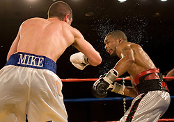 April 20, 2007; Atlantic City, NJ, USA;  Kendall Holt (silver/black trunks) and Mike Arnaoutis (blue/white trunks) trade punches during their 12 round bout at Bally's in Atlantic City, NJ.