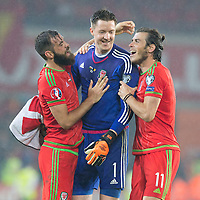 CARDIFF, WALES - Friday, June 12, 2015: Wales' Gareth Bale celebrates with Wales' Wayne Hennessey and Wales' Joe Ledley against Belgium during the UEFA Euro 2016 Qualifying Round Group B match against Belgium at the Cardiff City Stadium. (Pic by Paul Currie/Propaganda)