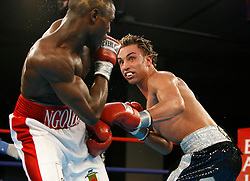 January 5, 2008; Newark, NJ, USA;  IBF Junior Welterweight Champion Paulie Malignaggi (black/silver trunks) and Herman Ngoudjo (white/red trunks) trade punches during their 12 round title fight at the Grand Ballroom of Bally's Hotel and Casino in Atlantic City, NJ.    Malignaggi retained his title via unanimous decision.